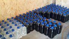 Підпільний алкогольний цех на Бориспільщині: прокуратура вилучила майже 3 000 літрів фальсифікату. Фото